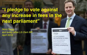 Clegg with pledge placard